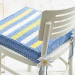 http://www.allfreecrochet.com/Miscellaneous-Crochet/Spring-like-Striped-Chair-Pad