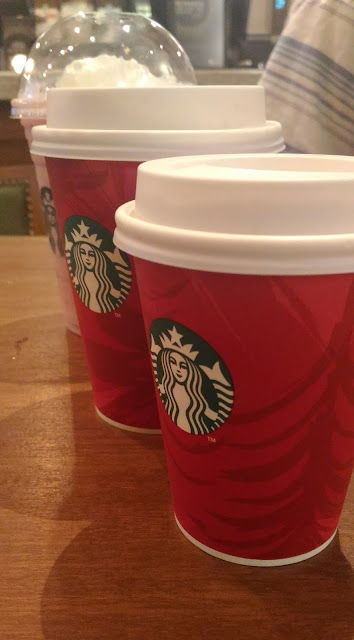 Dayle Pereira of the blog Style File reviews the ASUS Zenfone 2 Laser smartphone with a picture taken by the phone camera of Starbucks holiday special, the starbucks red cups
