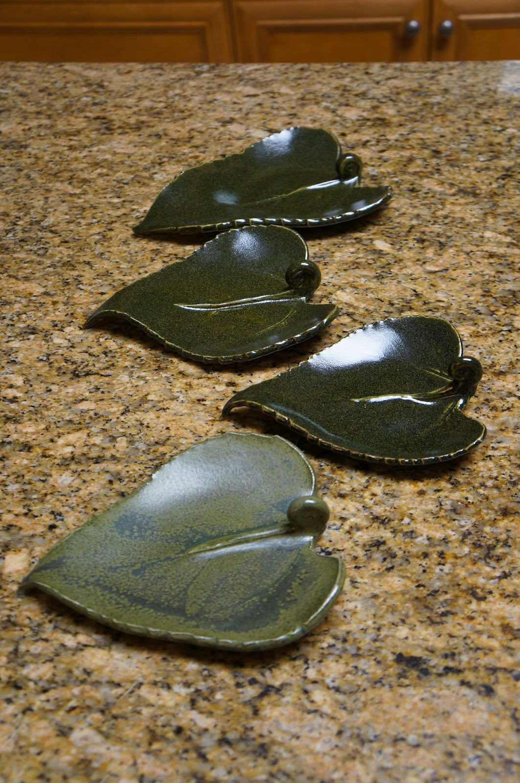 Beautiful unique handmade ceramic dishes made from real sunflower leaves.