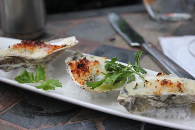 Warm oysters oreganato at Aragosta, Boston, Mass.