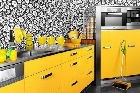 [A yellow kitchen with black, gray and white units]