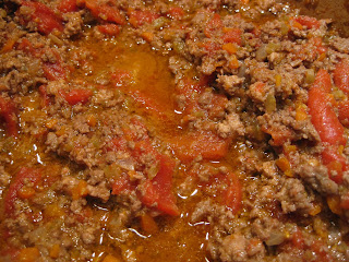 close up of meat sauce cooking in pot