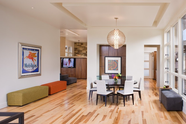 Photo of large modern dining room interiors with oak wood floor