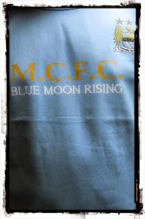 kaos bola blue moon rising murah