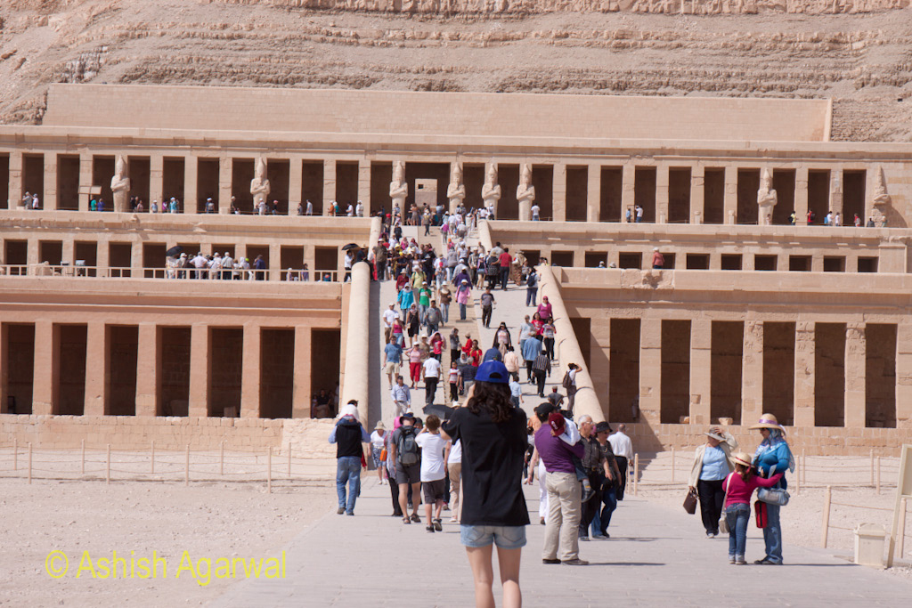 View of tourists thronging the Hatsheput temple complex, on the main path leading to the temple
