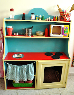 upcycled cupboard into children play kitchen