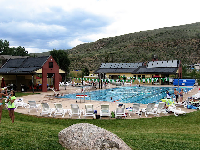 EagleVail Community Pool heated with a combination of Solene Aurora flat-plate solar thermal panels and Heliocol solar pool heating panels.