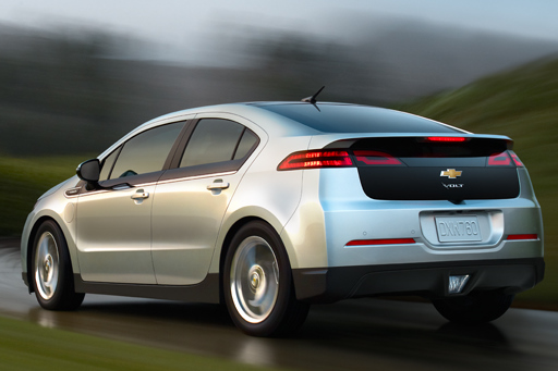 Rear 3/4 view of silver 2012 Chevrolet Volt driving in the rain