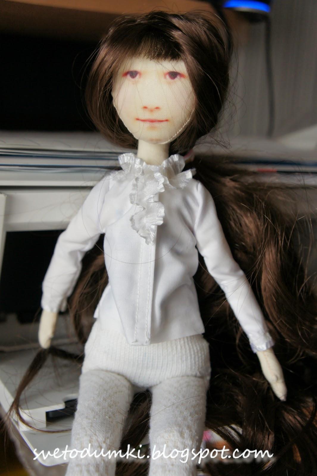 текстильная кукла с лицом девочки