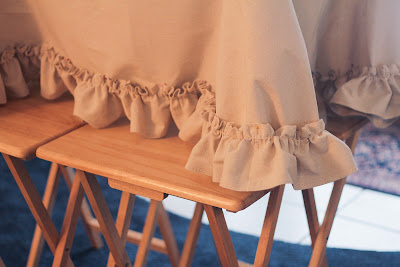 Pin the ruffle so it skims the floor; use a table or tray tables to bring it to eye level | Candy Hearts &amp; Paper Flowers
