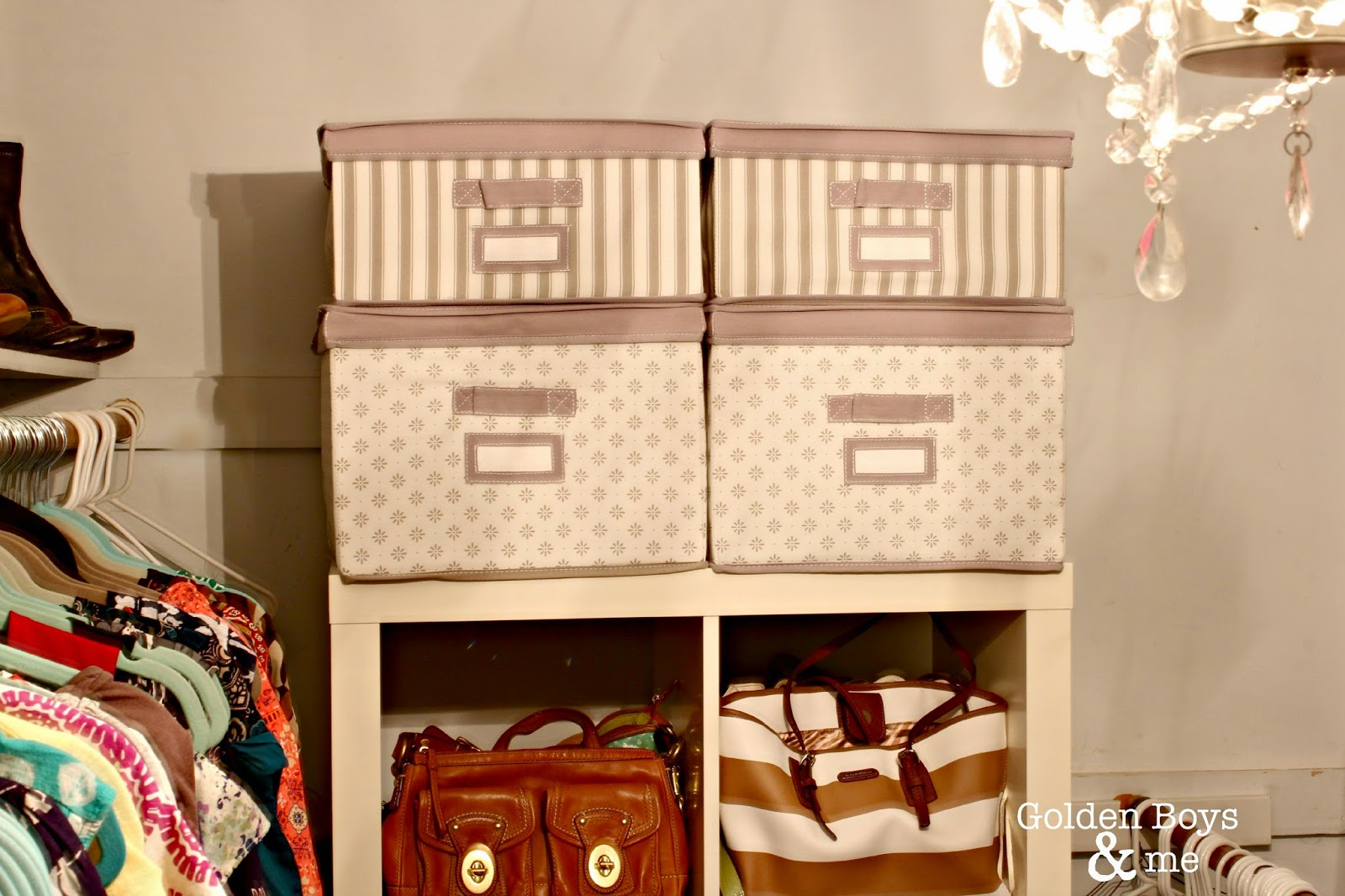 Ikea fabric storage boxes on Kallax sheving unit in master closet-www.goldenboysandme.com