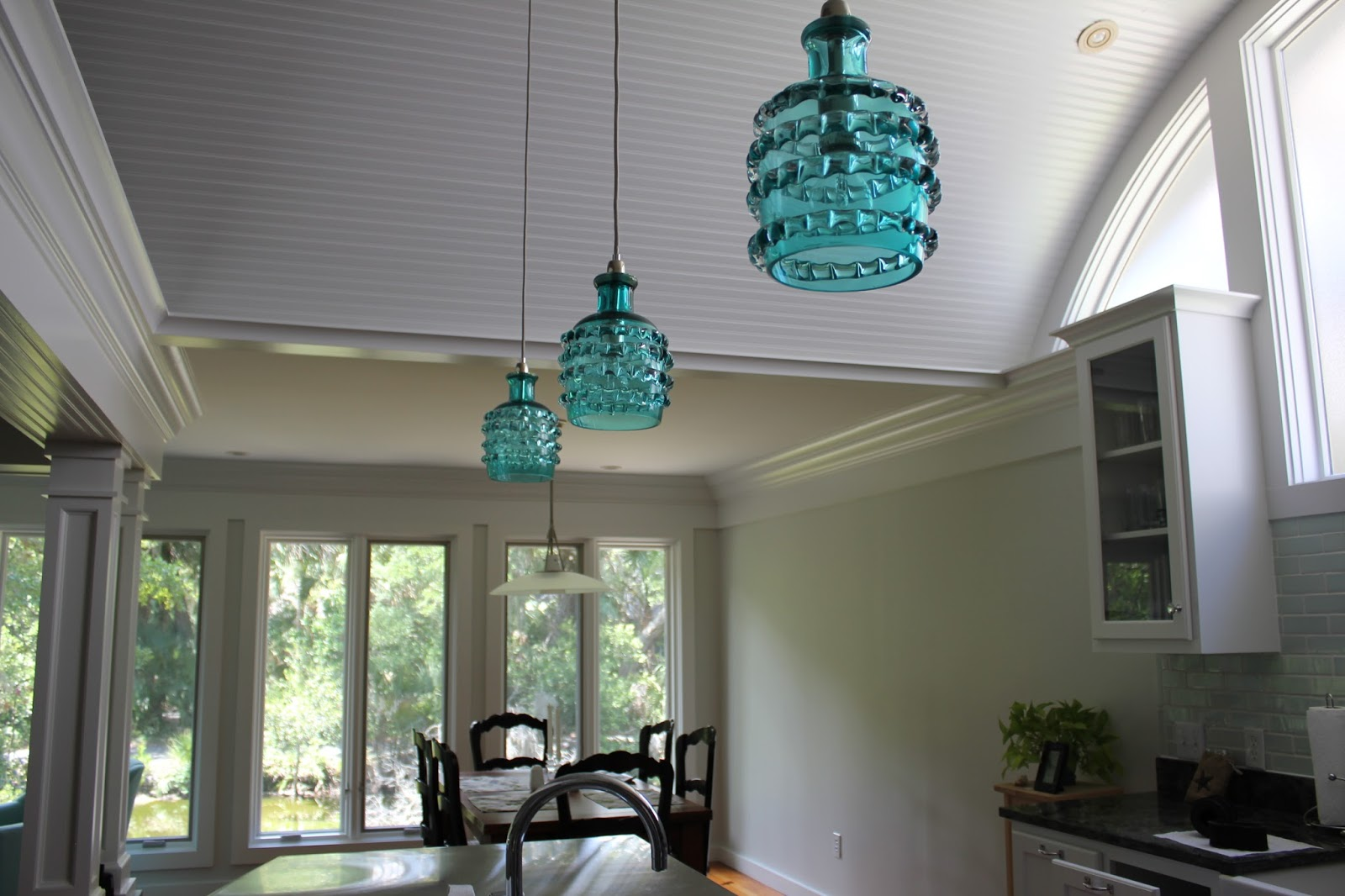 Beach house lighting - There Were Three Not So Fun Pendant Lights Hanging Over The Island That Had To Go They Were Replaced With Three Super Awesome Pendant Lights