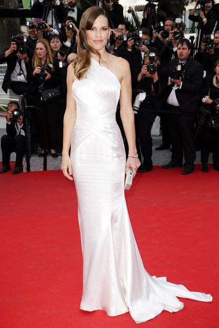 Hilary Swank in an Atelier Versace gown with sapphire Chopard jewellery and a Jimmy Choo clutch at Cannes 2014