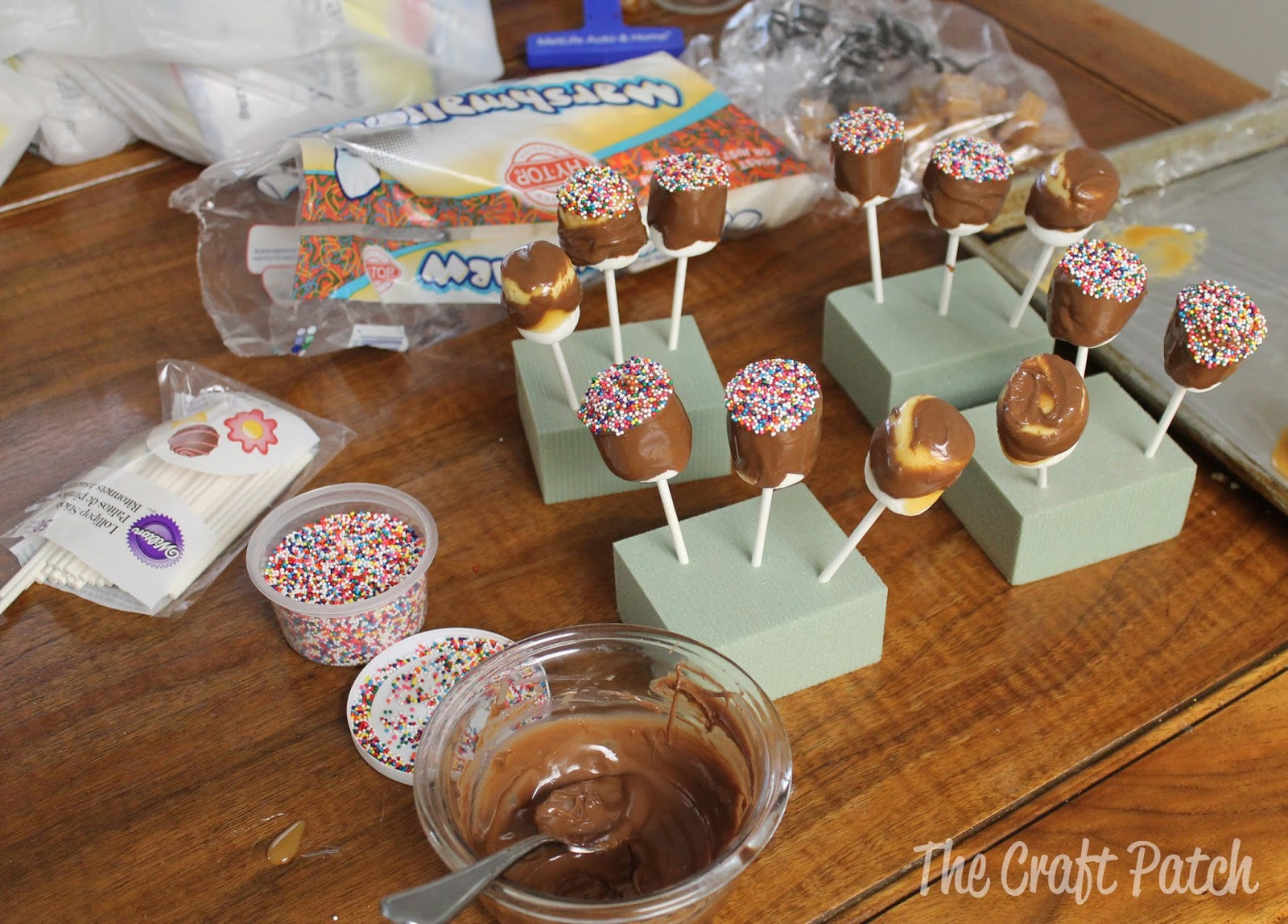 Putting the wet mallows into craft foam to dry worked really well! My marshmallow pops were much prettier since they didn't have a flattened side where they ...