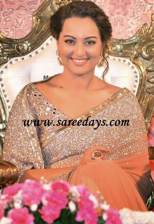 Latest saree designs sonakshi sinha in gold designer shimmer saree checkout sonakshi sinha in gold designer shimmer saree with shimmer work and gold border and paired with mirror work designer blouse altavistaventures Images