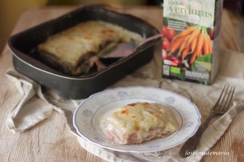 Lasaña de acelgas, jamón  y queso, cobertura de velouté y queso rallado sin lactosa