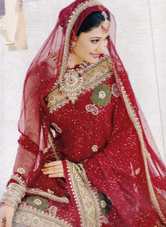 http://1.bp.blogspot.com/-WW8Rwr_idjU/Tnh7cq10U7I/AAAAAAAAAZY/xlrs5kbp9rI/s1600/bridal%2Bsaree.jpg