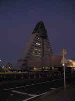Triangle shaped Apasm Center building from across the road