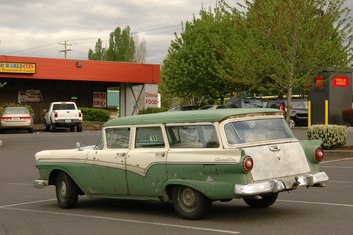 OLD PARKED CARS.: 1957 Ford Country Sedan.