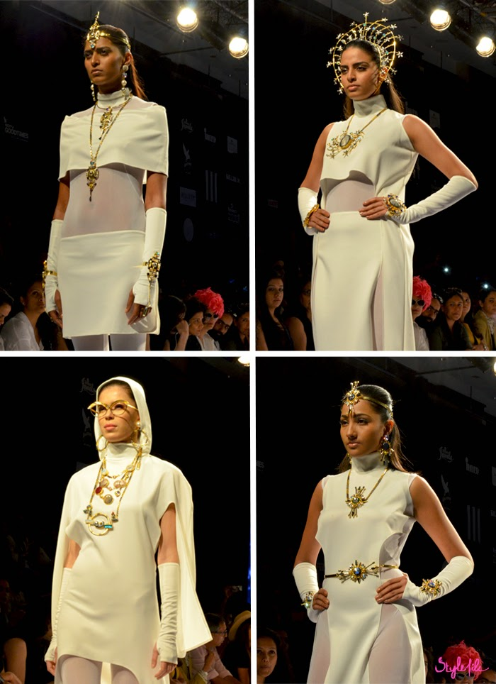 Model wears jewellery with metal and precious stones on her head, neck, arms and waist for Valliyan by Nitya Arora on the runway at Lakme Fashion Week Summer Resort 2015