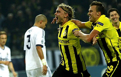 Schmelzer celebrates his goal against Real Madrid