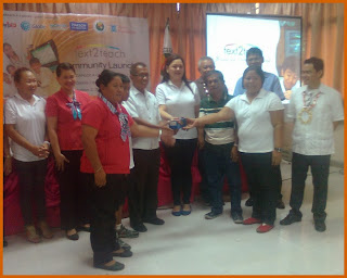 Cubay Elem. School stakeholders receiving the mobile phone for Text2Teach program