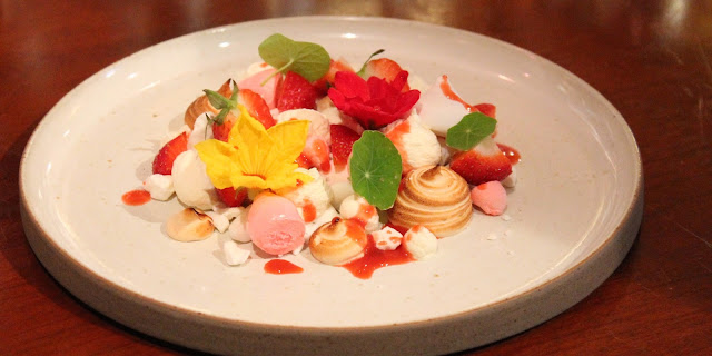 eton mess with edible flowers at Newbridge on Usk