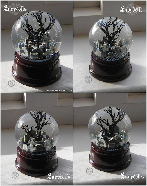the crow snowglobe