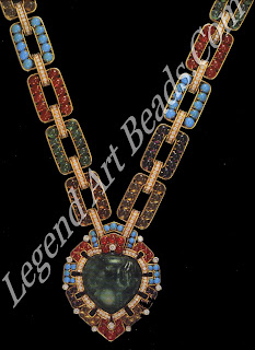 A sautoir created by the Italian jewellers Bulgari in 1969-70, formed by a chain set with cabochon amethysts, citrines, turquoises, emeralds, and rubies, supporting a carved emerald of 127.40 carats. Many of the stones were acquired by Bulgari from the collection of the Nizam of Hyderabad.