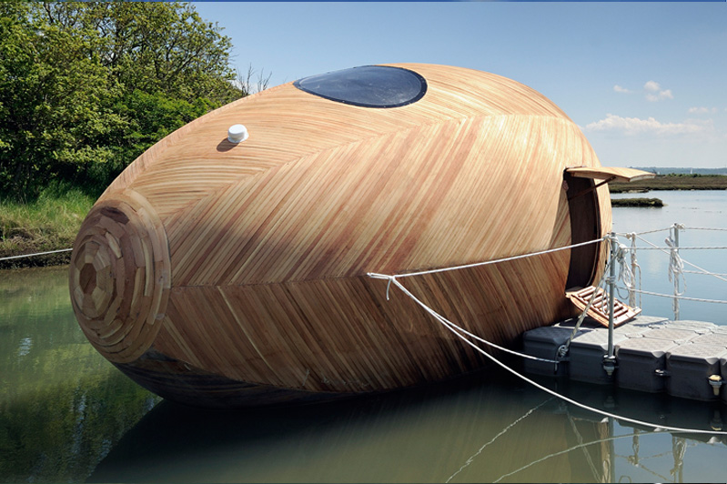 floating wooden sustainable egg pod is home to artist stephen