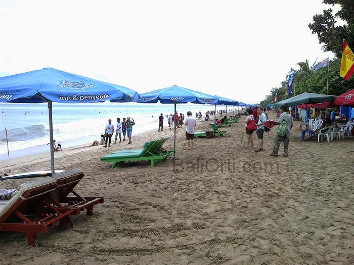 During the rainy season , the sand at Kuta Beach Bali brown , because wet
