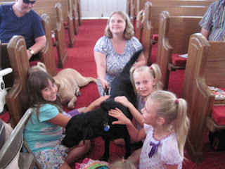 Brianna and her guide hang out with kids at Rehobeth UMC