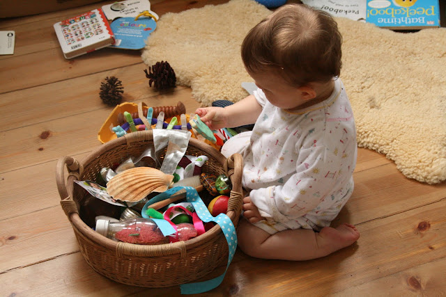 Baby play ideas and activities 6 18 months the imagination tree emptying and filling a material box negle Images