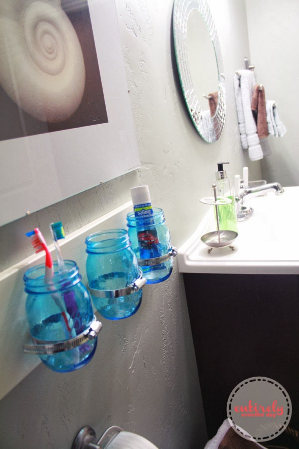 DIY Mason Jar Bathroom Organizer Video Tutorial. This is a fun idea and great tutorial. I am totally making this! www.entirelyeventfulday.com #videotutorial #diyproject #masonjars #bathroom #organization