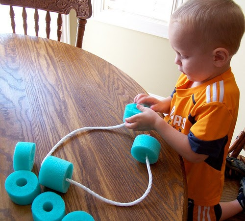 http://moneysavingmom.com/2011/08/busy-bag-idea-pool-noodle-stringing.html