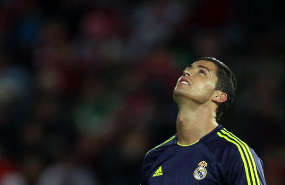 Real Madrid player Cristiano Ronaldo reacts after scoring an own goal against Granada