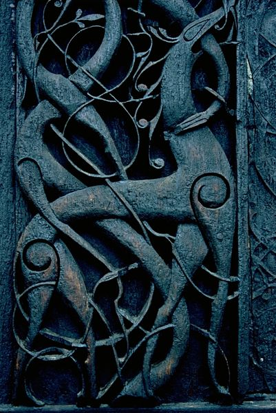 The swirling interlacing style of Viking art expressed in wood and metal