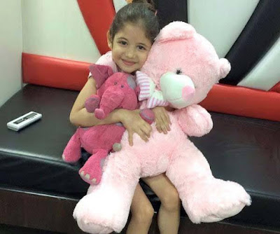 Munni aka harshali playing with teddy bear photo