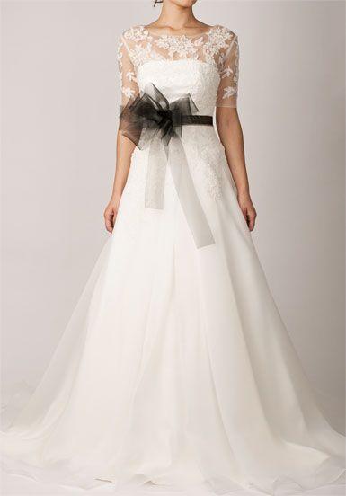 White laced wedding dress with black belt