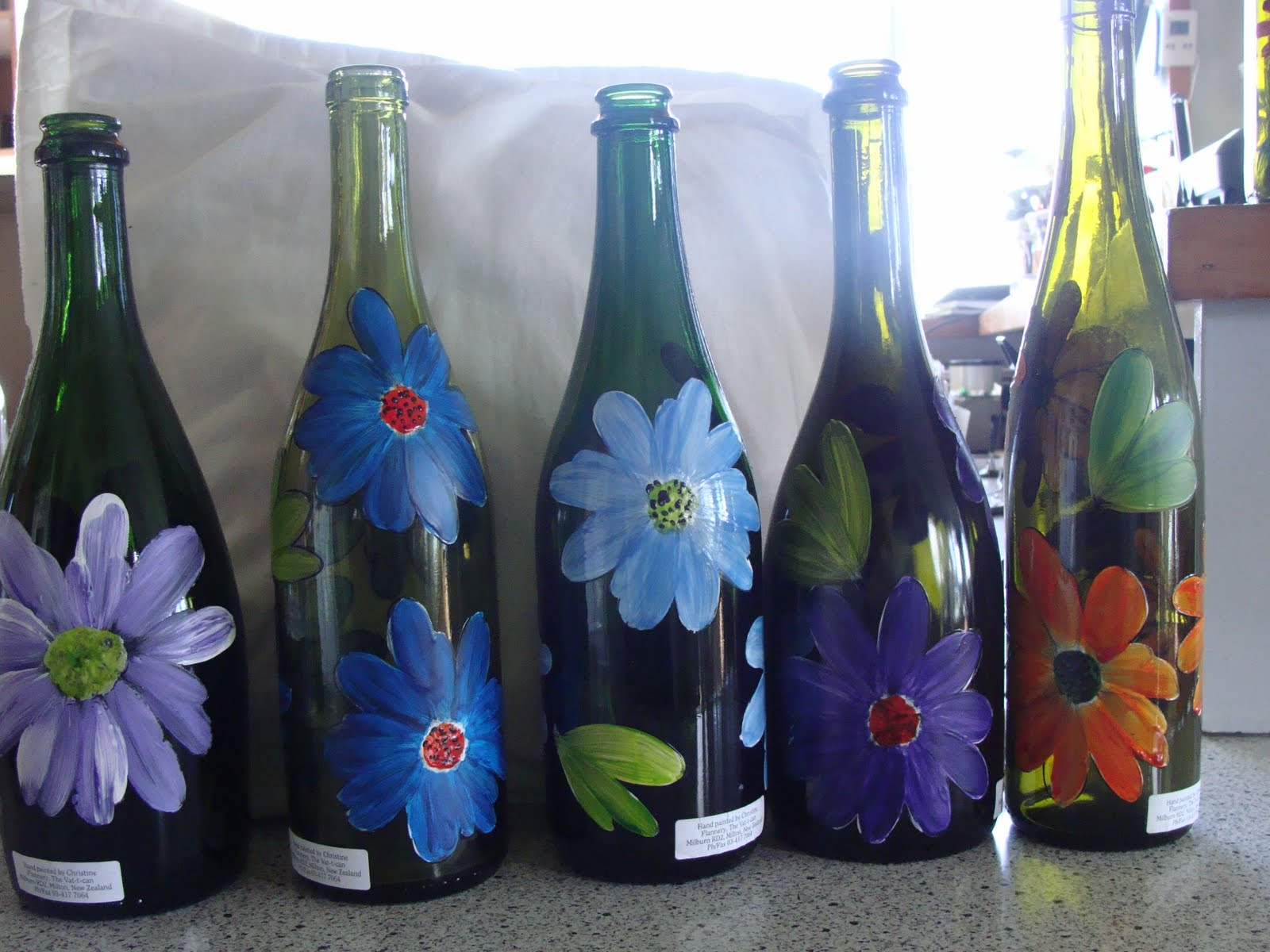 Christine flannery glass painting hand glass painting bottles Painting old glass bottles