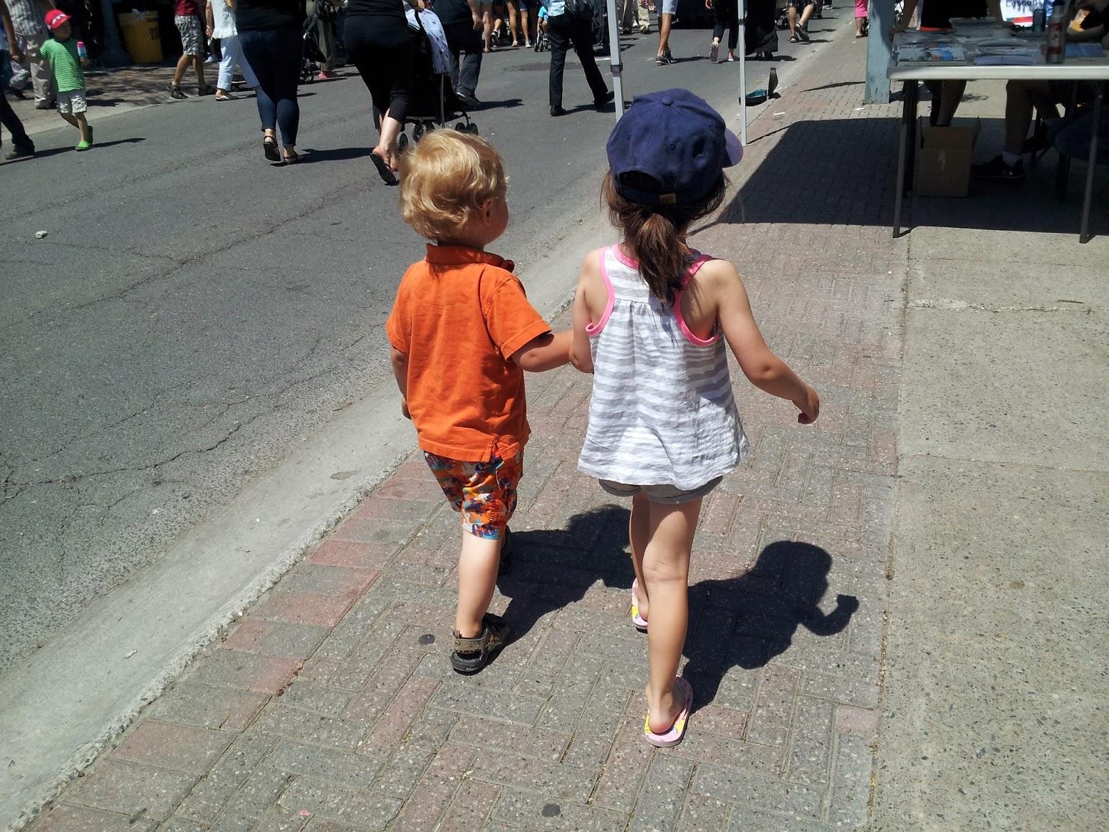 Cousins, kids, family, walking, Main Street, small-town festival