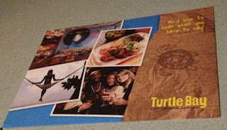 postcard with Turtle Bay written on it and pictures of beaches and happy people