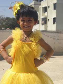 baby doll in yellow frock in the annual day