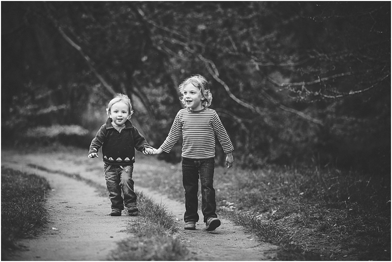 Two young brothers walking hand in hand