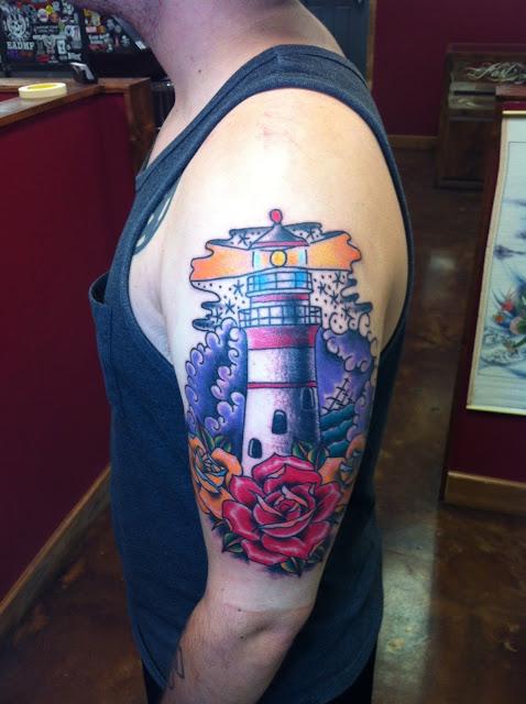 Cool Traditional Lighthouse and roses half sleeve arm tattoo by David Meek Tattoos at Fast Lane Tattoo Tucson Arizona