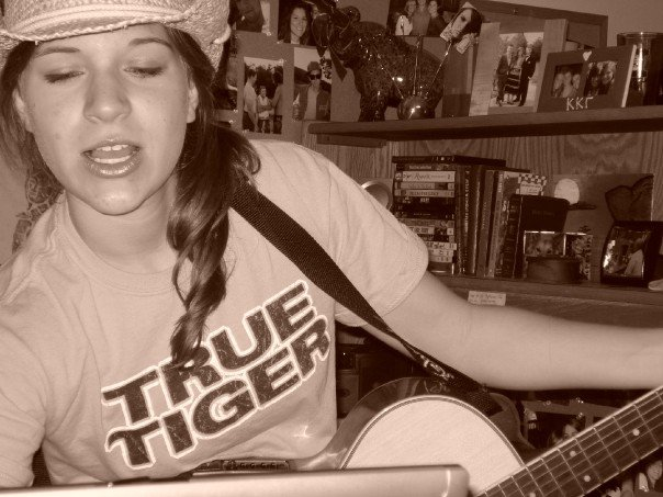 Mizzou True Tiger playing guitar