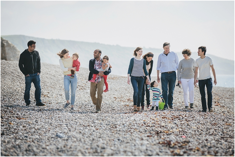 Extended family walking across the beach together