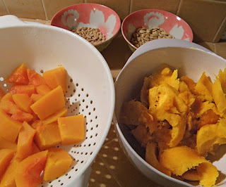 Steamed Butternut and Pumpkin in two Bowls with seeds in background