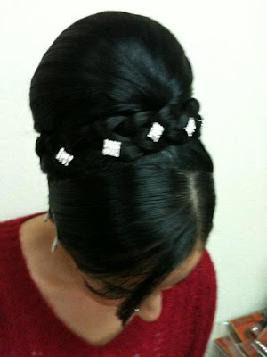 Beautifully made up-do with white buttons added.