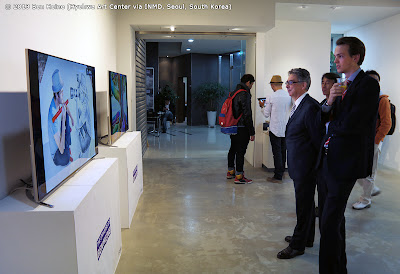Ben Heine Digital Display on Samsung Smart Televisions watched by Ambassador Francois Bontemps and Consul Pierre Steverlynck